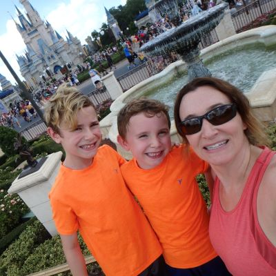 All smiles in front of Cinderella Castle at Magic Kingdom
