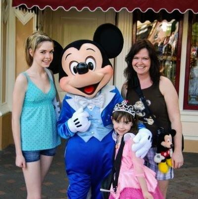 Me and my girls with Mickey Mouse at Disneyland in California